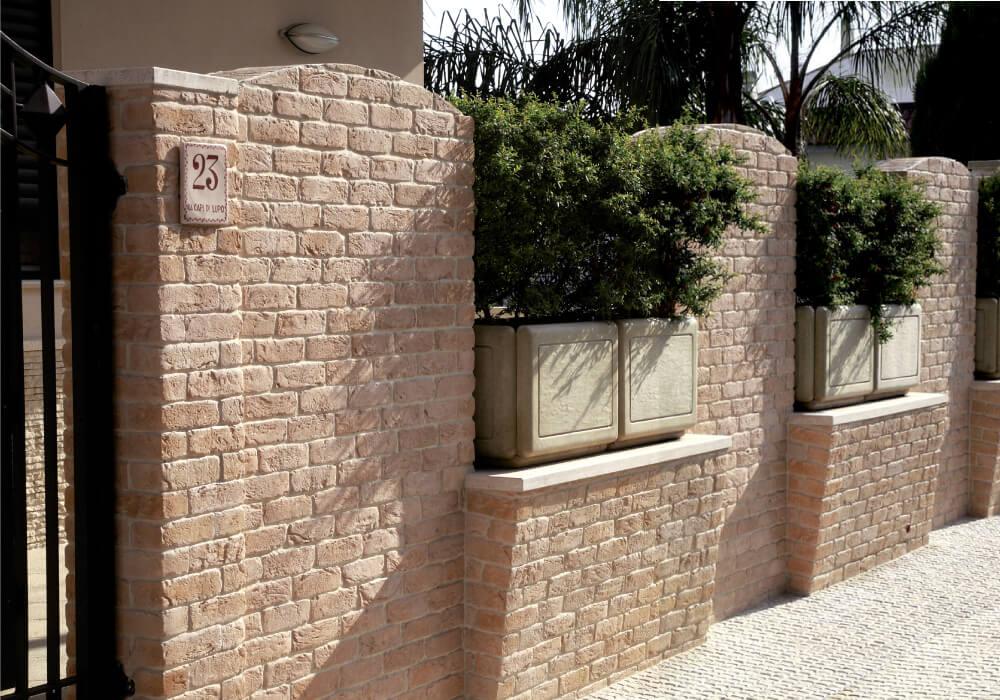 muretto con rivestimento mattoni pietra primiceri